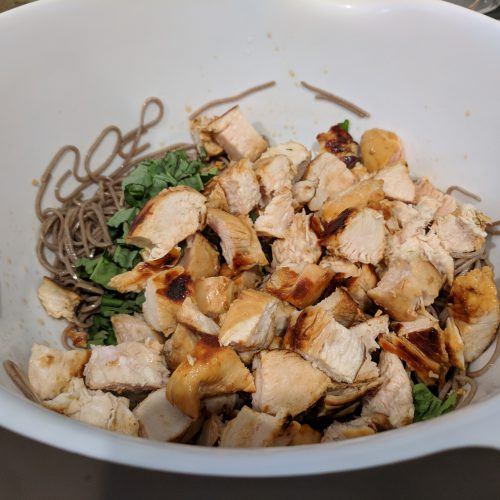 chicken soba noodle add basil and chicken to bowl