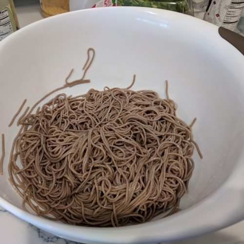 chicken soba noodle put noodles in a mixing bowl