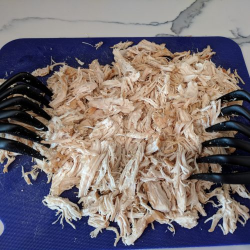 take chicken out of instant pot and shred with claws or 2 forks