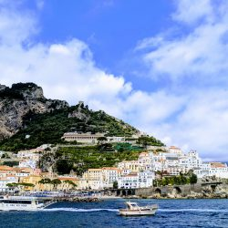 view of amalfi from ferry to positano