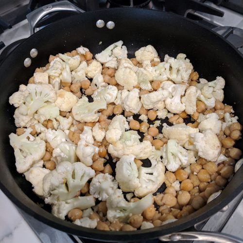 add cauliflower and evoo to garbanzo bean pan