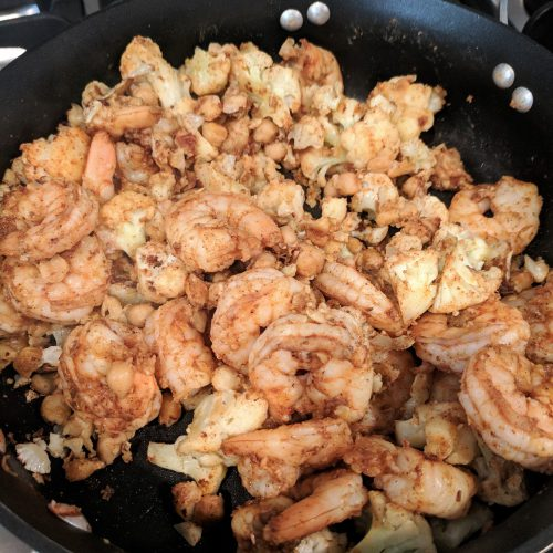 add shrimp to cauliflower pan and stir
