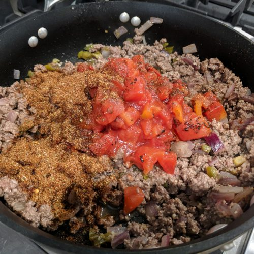 taco spaghetti add spices tomatoes jalepenos