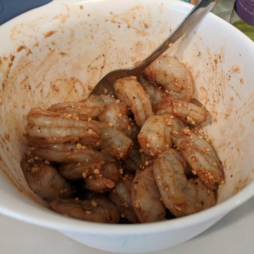 toss shrimp with spices