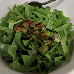 in a md bowl combine bok choy sliced green scallions and dressing