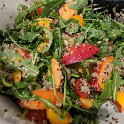 peach and quinoa salad in a lg mixing bowl combine 4 cups arugula 2 cups tomato halves 2 cups peach slices quinoa .5 tsp salt 3 tbsp olive oil 2 tbsp rice vinegar. toss. v2